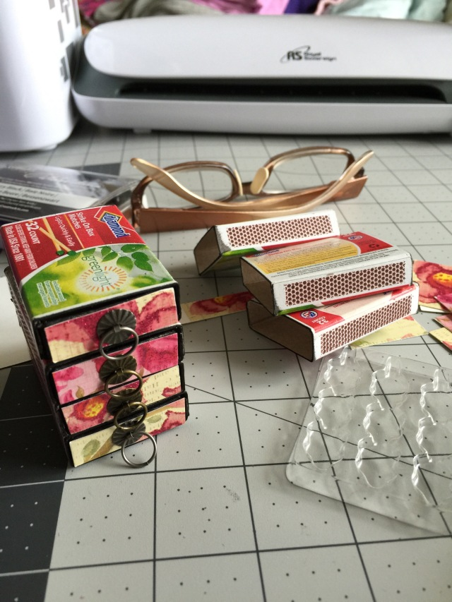 Making a minature dresser out of a set of matchboxes.